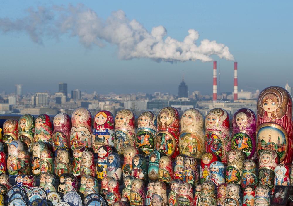 Matryoshkas, traditional Russian wooden dolls, are displayed for sale on a cold winter day in the Sparrow Hills, the site of tourist attraction in Moscow, Wednesday, Dec. 12, 2012. Temperature is about -10 C (14 F).