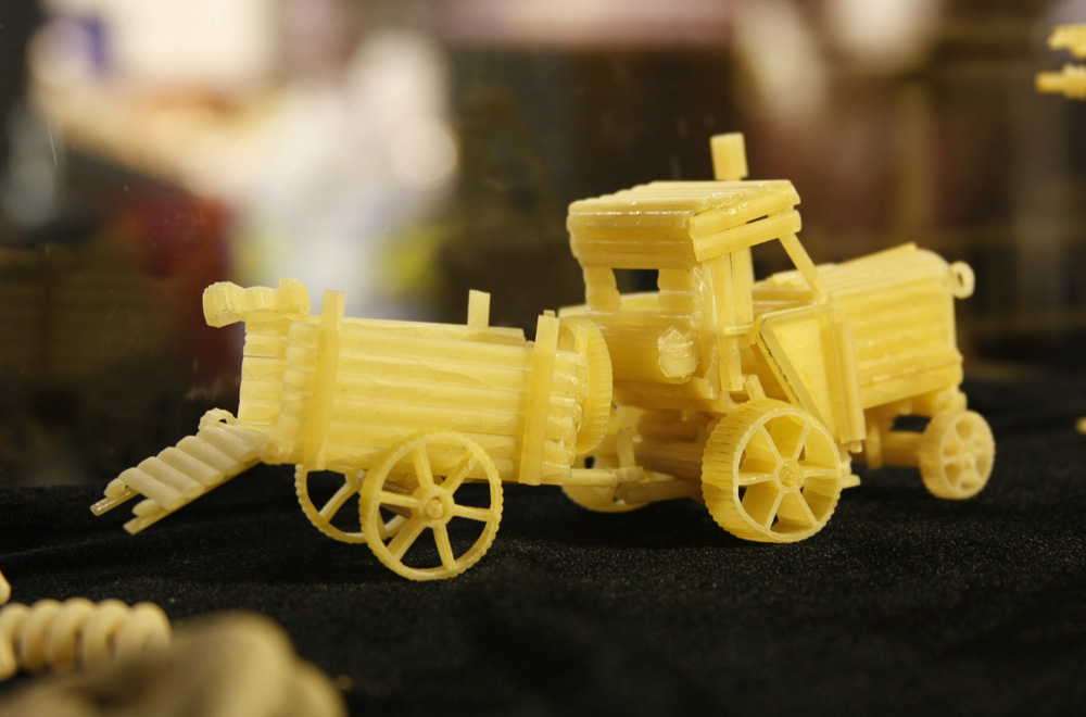 """Today the macaroni collection includes cars, motorcycles, tanks, planes, a tractor-trailer, a cistern, an asphalt roller, a helicopter, a yacht, and even a village with one house and a mill. """"Pasta Town"""" took three years to build, and each model approximately 30 hours."""