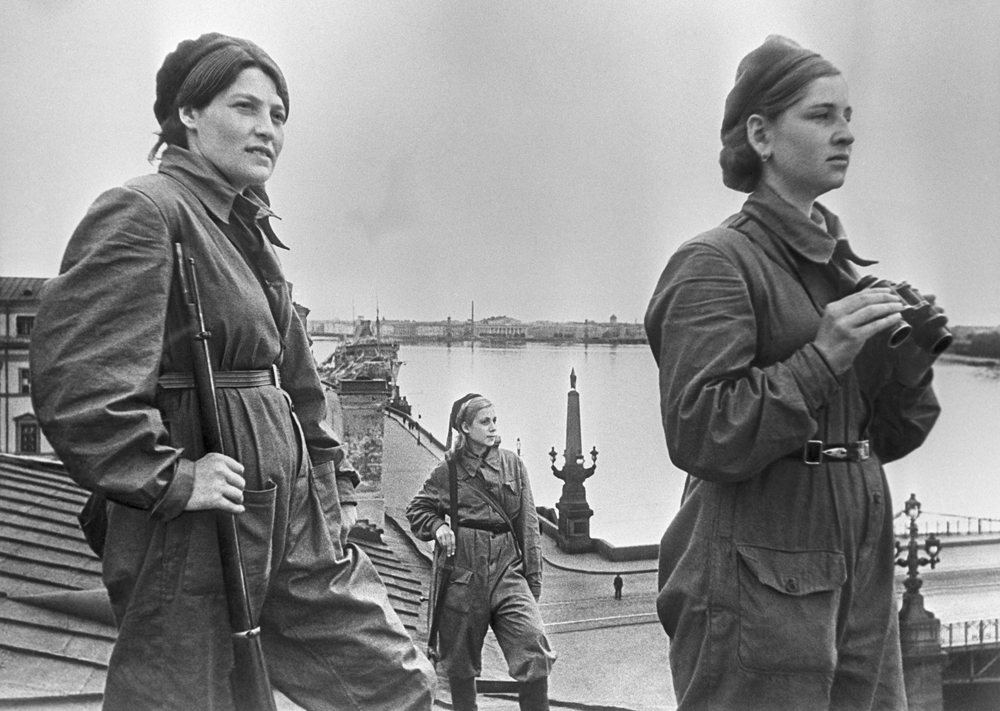 "In December, the operation plan was approved by the Stavka and received the codename ""Iskra"" (Spark). The breakthrough of the Siege was undertaken January 18 after more than a yearlong blockade. It let the Soviet army create a land corridor to Leningrad which allowed more supplies to reach the city. // Girls on duty on the roof in besieged Leningrad. Air defense."