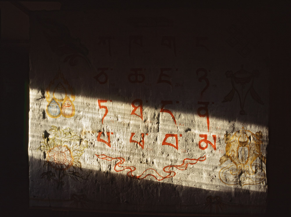 In sacred Buryat places, swearing, fighting, and dropping litter are strictly forbidden. On the territory of datsans (Buddhist university monasteries), one should move from left to right, following the path of the sun. (The photo depicts Tibetan syllables. A painting on a stove inside a datsan).