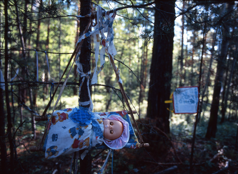 A cradle in the Alla sacred grove. It is hung up by childless parents during a ceremony to summon forth a child, which is conducted by the local shaman.