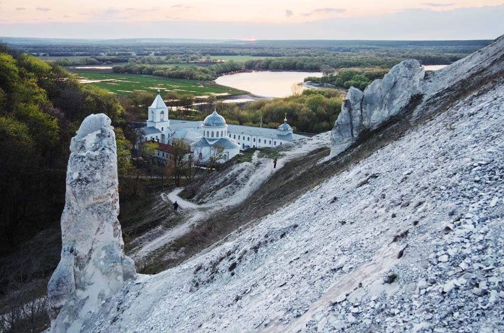 The view of the Uspensky Divnogorsky Monastery and the Don River (Voronezh region, about 290 miles from Moscow) // The history of the first cave monasteries started a long time ago. In the earliest days of Christianity the Roman catacombs were used for religious services.