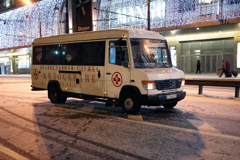 "Moscow's ""Mercy"" charity, sponsored by the Orthodox Church, has been working to rescue ailing vagrants since November 2004. Crew of volunteers take a specially equipped bus out by day to administer first aid to sick people few else would think of touching."
