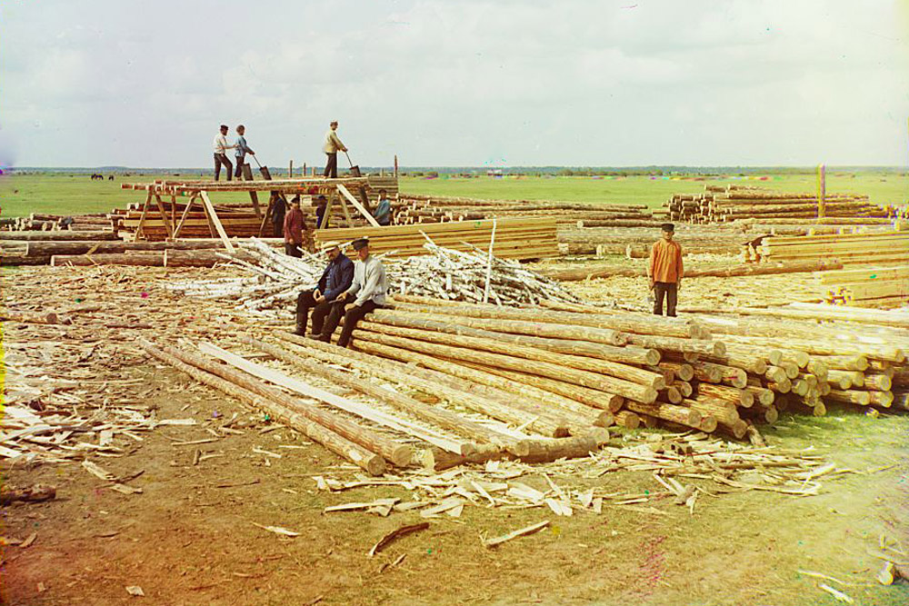 Log sawing. Kuzminskoe village along the Oka River. 1912 // His subjects ranged from the medieval churches and monasteries of old Russia, to the railroads and factories of an emerging industrial power, to the daily life and work of Russia's diverse population.