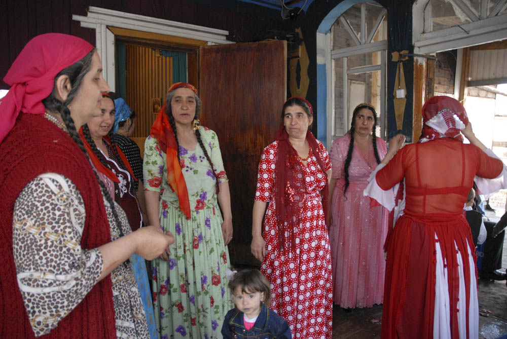 The impossibly beautiful attire of the women, the black curious eyes of the children, the gold teeth of the sturdy men, and the silver threads in the long braids of the infinitely alluring gypsy babushkas.