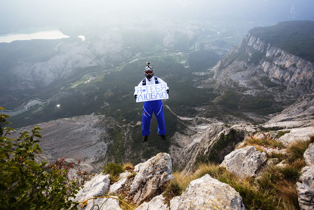 I love you (written on the poster)//These stunning photographs were taken by Vadim Makhorov, Russian photographer from Novosibirsk during his base-jumping trip with friends to Europe.
