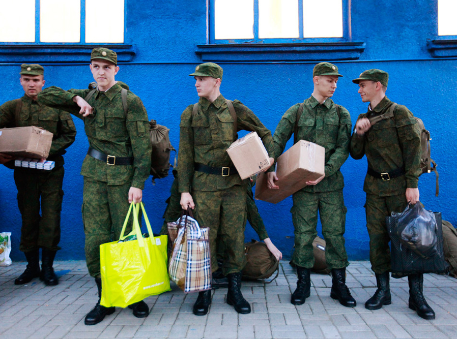 Russian conscripts, wearing military uniforms, gather at a local railway station before their departure in Stavropol. The conscripts will serve in Moscow in the Kremlin regiment, also known as Presidential regiment, which is part of the Federal Guard Service.