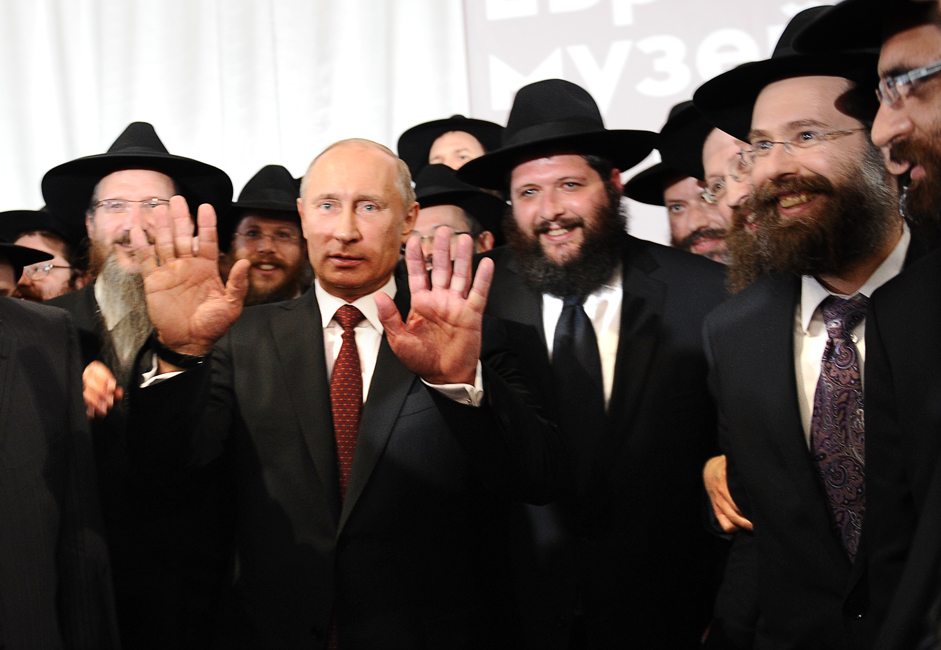 Russia's President Vladimir Putin (C) speaks at a ceremony marking the handover of the Schneerson library at the Jewish Museum and Tolerance Centre in Moscow.