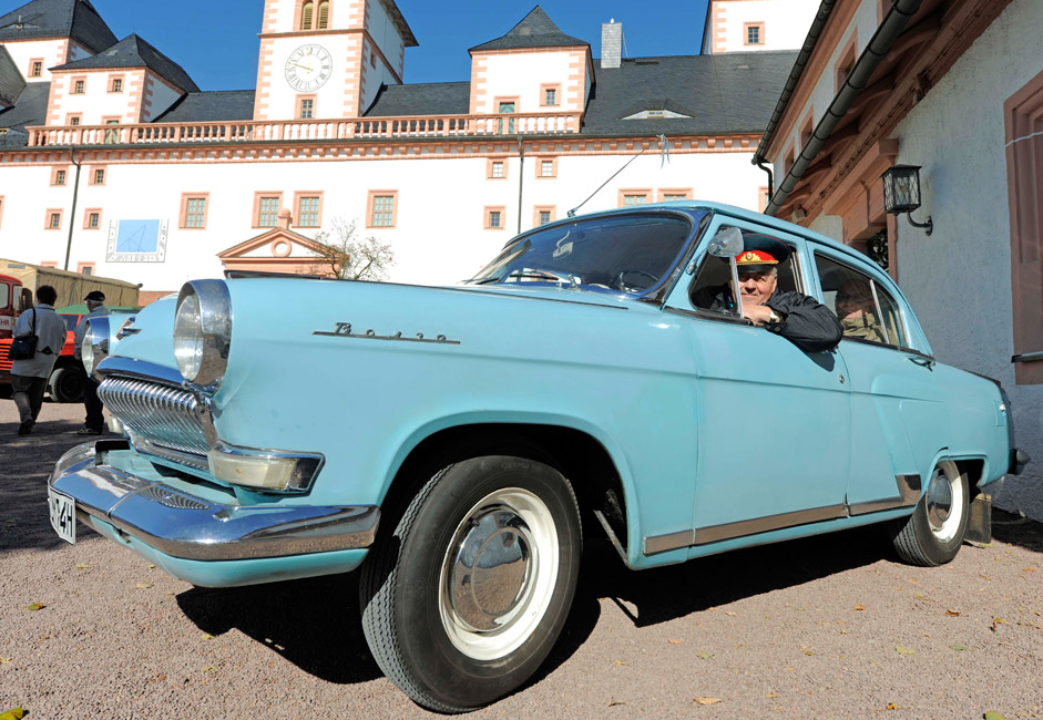 Leberecht Minuth starts with his Russian Volga car in front of the Augustusburg Castle in Augustusburg, eastern Germany. About 500 vehichles produced up to 1970 gathered at the event.