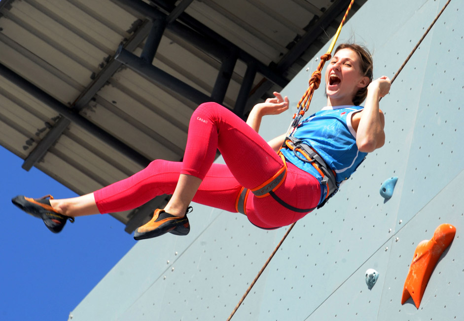 Alina Gaidamakina of Russia celebrates after winning the women's speed final of 2013 International Federation of Sport Climbing (IFSC) Climbing World Cup in Haiyang, east China's Shandong Province.  Alina Gaidamakina won the gold medal of the event with 8.54 seconds.