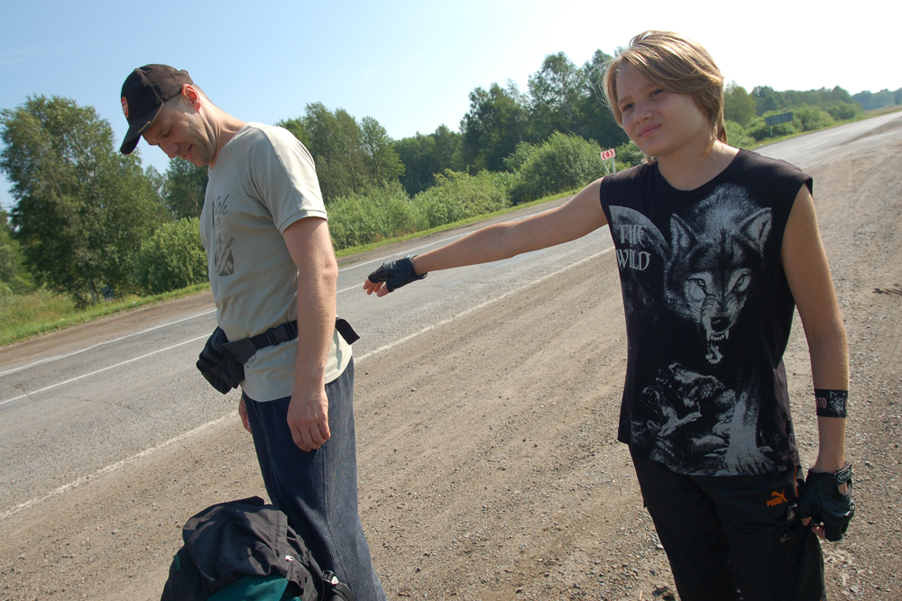 Drivers encounter hitch-hikers of all ages (15-65), gender, and social status. Hitch-hiker Pyotr and son (pictured). Pyotr is teaching his son to hitch-hike from an early age, but does not let him do it alone. That will happen when he turns 18.