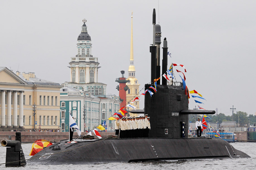 A Russian submarine is anchored on the Neva River in front the Pawel and Peter Fortress during preparations for Navy Day in central St. Petersburg, July 25, 2013. Russia will mark its Navy Day on Sunday.