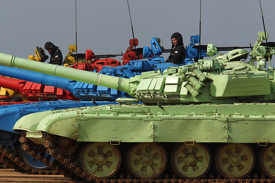 Crews work in four T-72B tanks that are painted red, green, yellow, and blue to make them more visible and to better determine if they accomplished their goals.