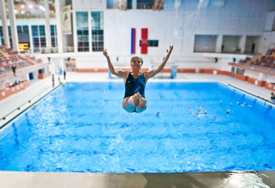 "When Yevgenia Stepanova turned 60, she decided to become a professional athlete. Having chosen high-board diving as her sport, she began active training. Now 74, Yevgenia and her sporting career are in full bloom. ""I'm about to move up an age group: over 75,"" she explains. ""My main rival, who is Austrian, is three years younger than me. So for at least three years, I will be the strongest in the group and can win many medals!"""