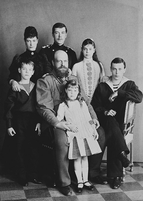 The future spouses' next meeting occurred 5 years later, when Alexandra Fyodorovna spent a month and a half visiting her sister in Saint Petersburg. Nikolai's parents were against their marriage. / Alexander III, his wife and their children