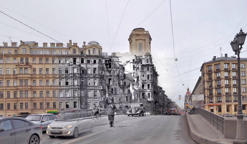 Žena regulira promet ispred razorene zgrade u ulici Voznesenjski prospekt preko rijeke Fontanke.