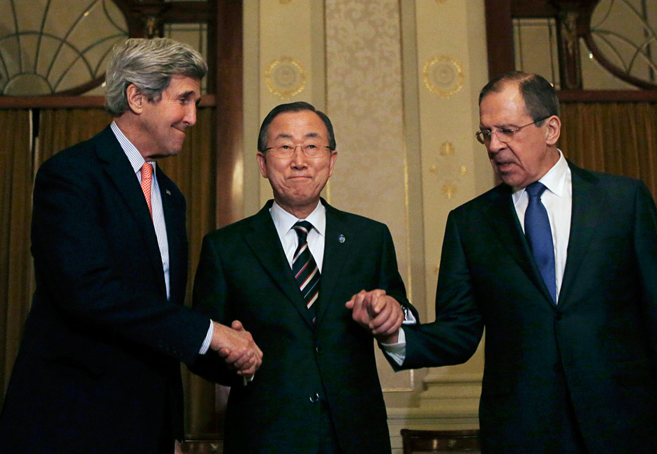 U.S. Secretary of State John Kerry (L-R), U.N. Secretary-General Ban Ki-moon and Russia's Foreign Minister Sergey Lavrov join hands after their tri-lateral meeting in Montreux, Switzerland.