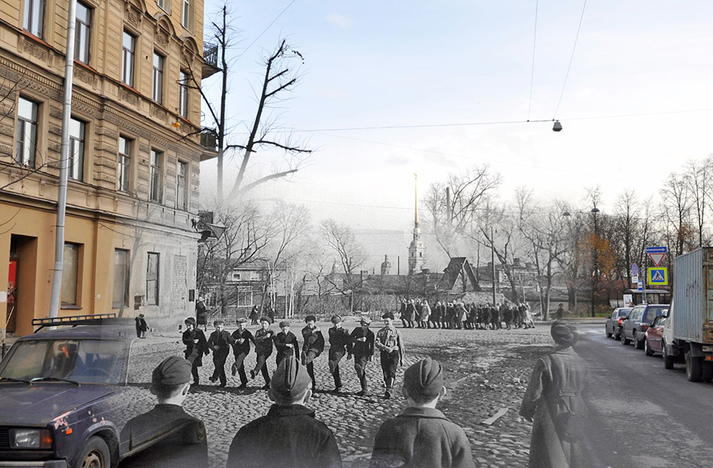 Schoolboys in the Petrograd District doing parade drills on Zverinskaya Street. The Peter and Paul Fortress is visible in the background.