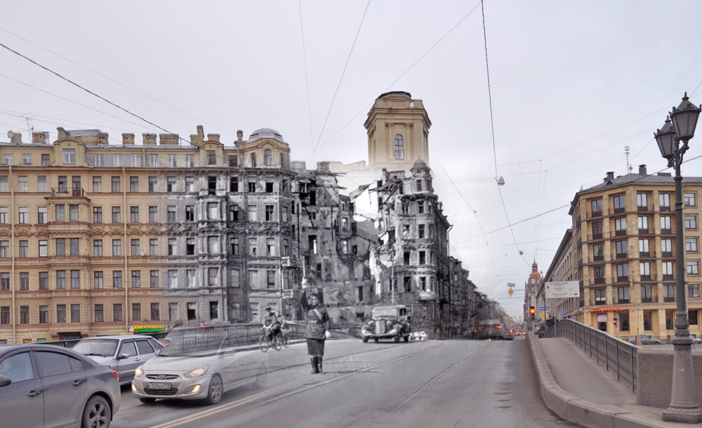 A woman directs traffic in front of a bombed-out building at the intersection of Voznesensky Prospekt and the Fontanka River.