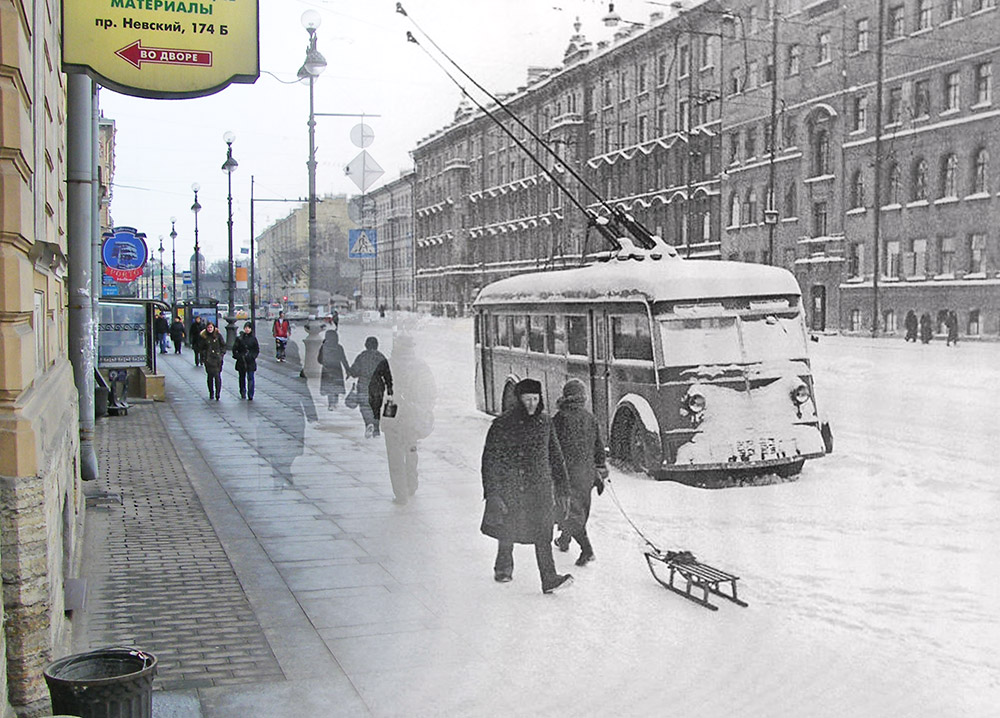 Pedestrians pass an abandoned trolleybus at 174 Nevsky Prospekt. Without electricity it was impossible to operate a public transportation system.