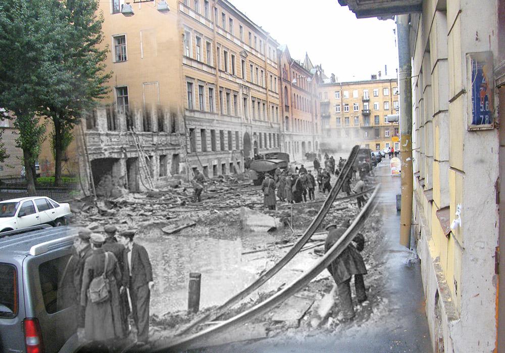 Leningrader begutachten die Schäden an einem Haus in der Dmitrowski Gasse in der Nähe der Wladimir-Kathedrale.