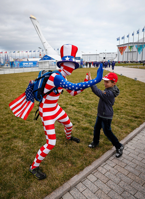 A U.S. fan greets a boy in the Olympic Park during the 2014 Winter Olympic Games in Sochi.