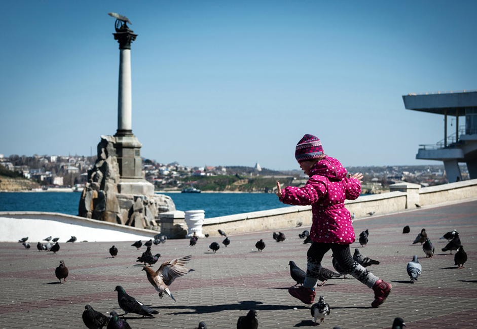 A child on the waterfront in the city of Sevastopol.