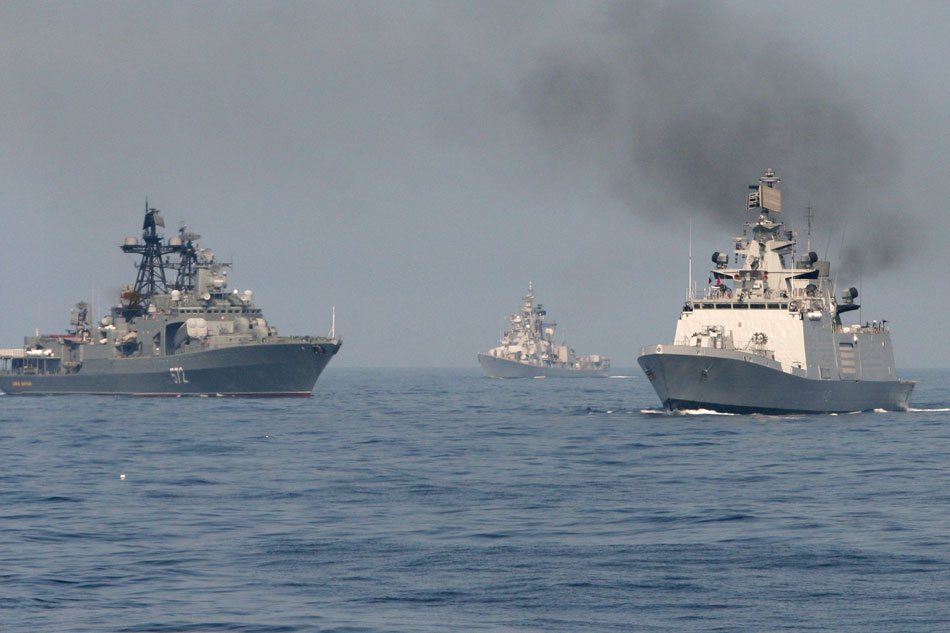 "Joint maneuvering of Indian and Russian military vessels during the naval exercise Indra-2014. Left: the destroyer ""Admiral Vinogradov"" of the Russian Pacific Fleet."
