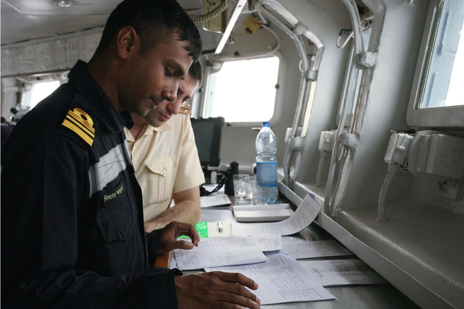 "Russian and Indian navy officers on board the guided-missile cruiser ""Varyag""."