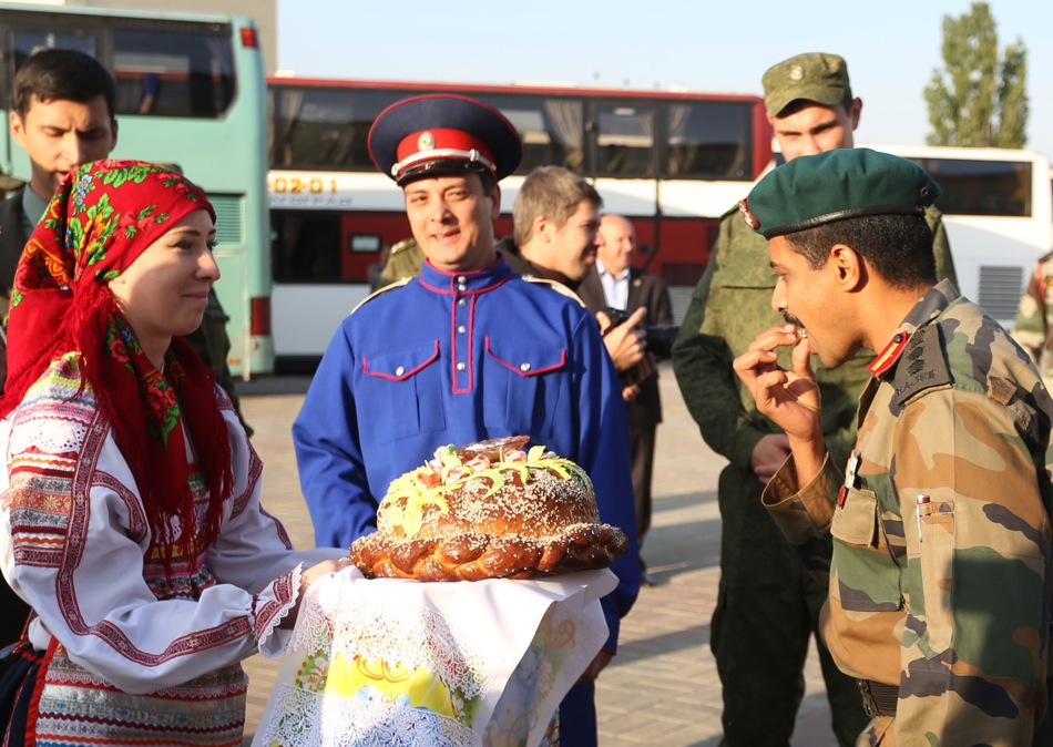 A traditional Russian bread-and-salt welcome for Indian servicemen, who arrived at the Volgograd Airport for participation in the Russian-Indian Indra-2014 tactical exercises.