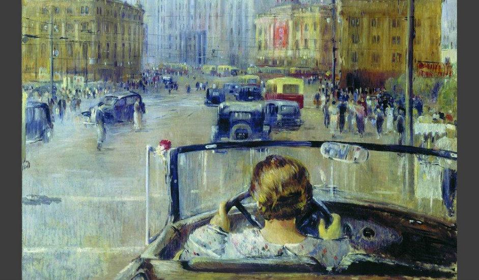 """12/12. """"Нова Москва"""", Јуриј Пименов, 1937. Ова слика је део серије радова о Москви сликара Јурија Пименова, ствараних почев од средине 1930-их. Жена за воланом је за његове савременике била симбол новог живота, нове Москве."""