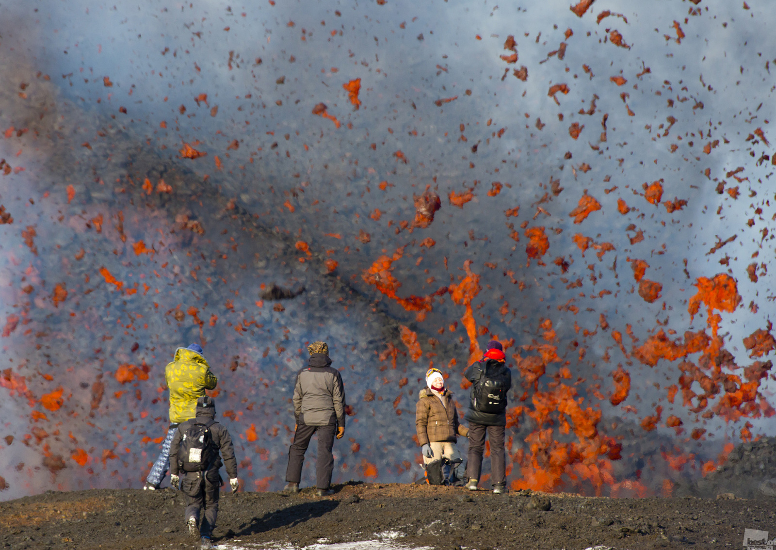 Tourists watch lava fountains from a distance of just 300 meters after an eruption of the volcano Plosky Tolbachik, Kamchatka