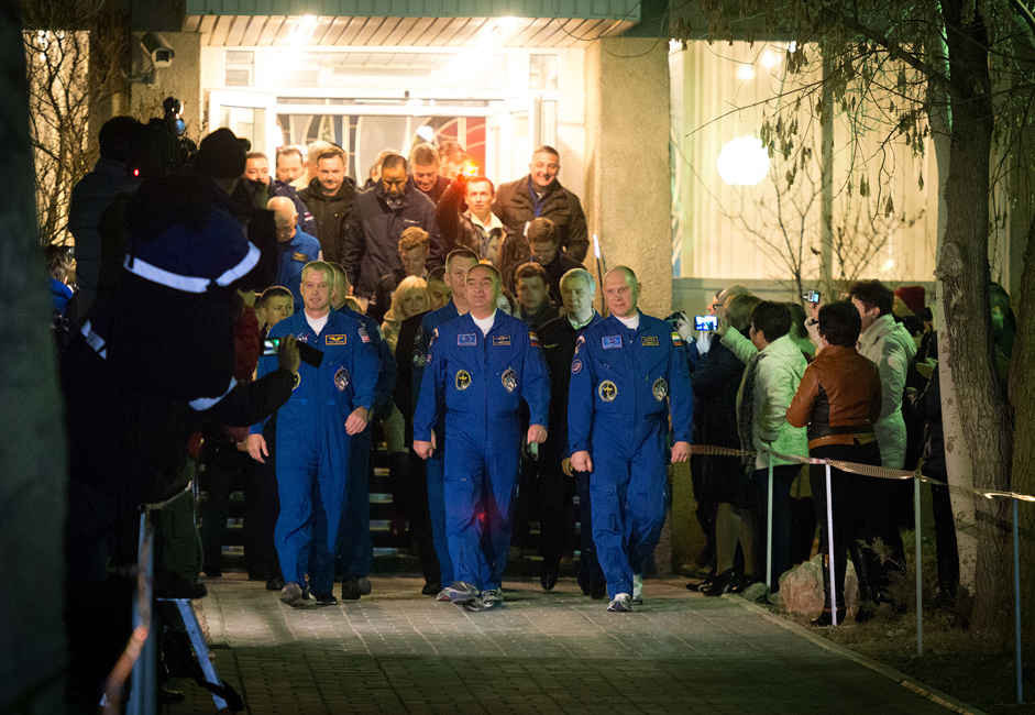 """Roscosmos cosmonauts Alexander Skvortsov and Oleg Artyomov with NASA astronaut Steven Swanson. 6 hours before liftoff, the crew of ISS-39/40 leaves the hotel to a song by the rock band Zemlyane (Earthlings) """"The Lawn At Home"""" and get in the bus that will take them to the launch pad."""