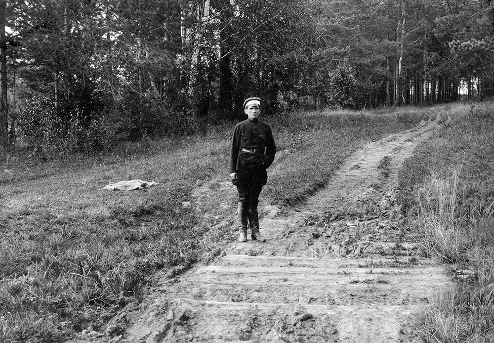 One of the regicides, revolutionary Peter Ermakov, on a small bridge over some sleepers in Porosenkov Ravine, where the bodies of the Imperial family and their servants were hidden. 1924. According to the guard Strekotin, Peter Ermakov finished off the dying members of the family with a bayonet.