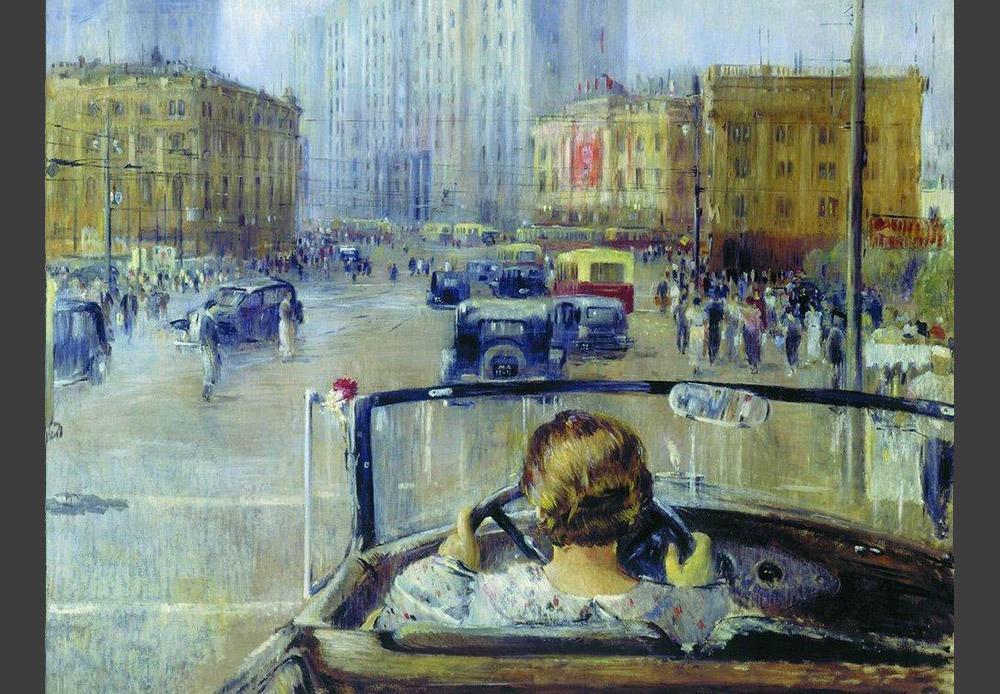 Au milieu des années 30, Youri Pimenov a débuté une série de toiles représentant Moscou, dont ce tableau fait partie. À l'époque, il était plutôt rare de voir une femme au volant d'une voiture. Aux yeux des contemporains de l'artiste, cette image symbolisait une vie nouvelle et un Moscou nouveau. / Le Moscou nouveau, Youri Pimenov, 1937.