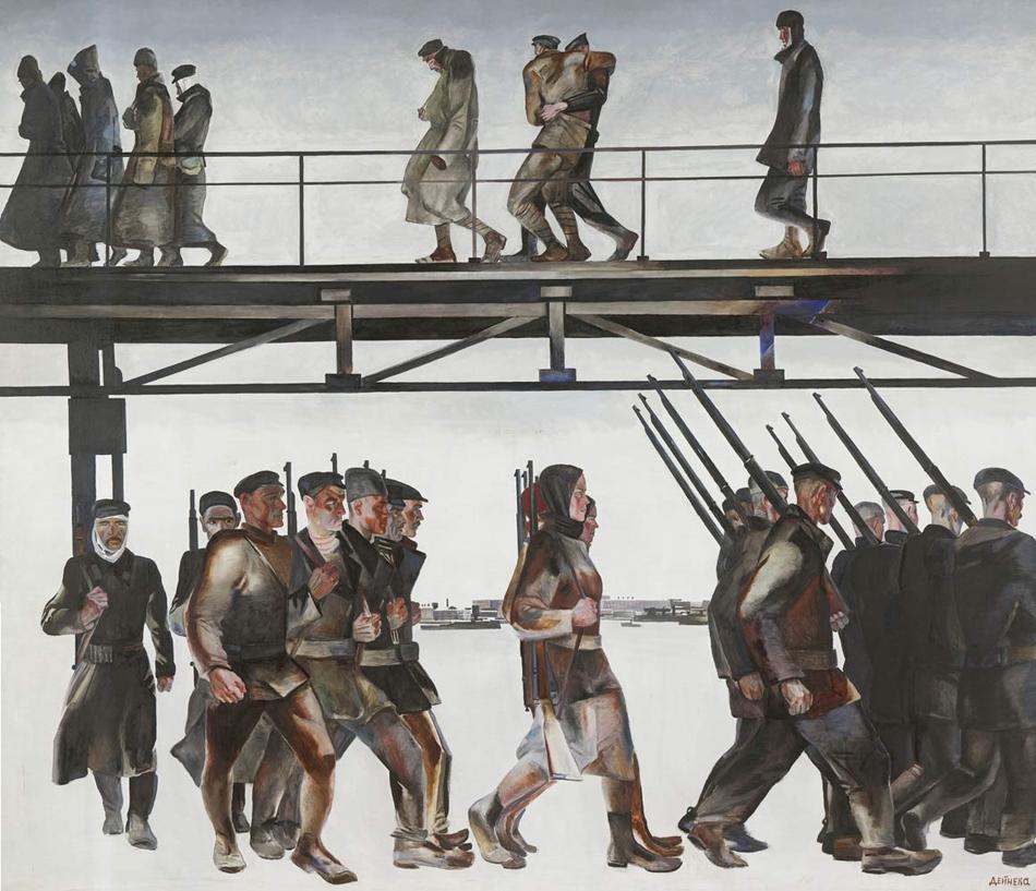 """Ранният Дейнека се отличава с изключително графично, ритмично качество. Художникът използва тенденциите на самата епоха, за да се оправдае, като смята, че времето е """"по-графично, отколкото живописно"""". През 1928 г. той създава една от най-известните си творби – пропита с патос историческо-революционна картина, която по-късно описва като """"любимото си платно"""" – """"Отбраната на Петроград"""", на която работници от Петрограт са тръгнали да се бият срещу Юденич. / """"Отбраната на Петроград"""", 1928 г."""