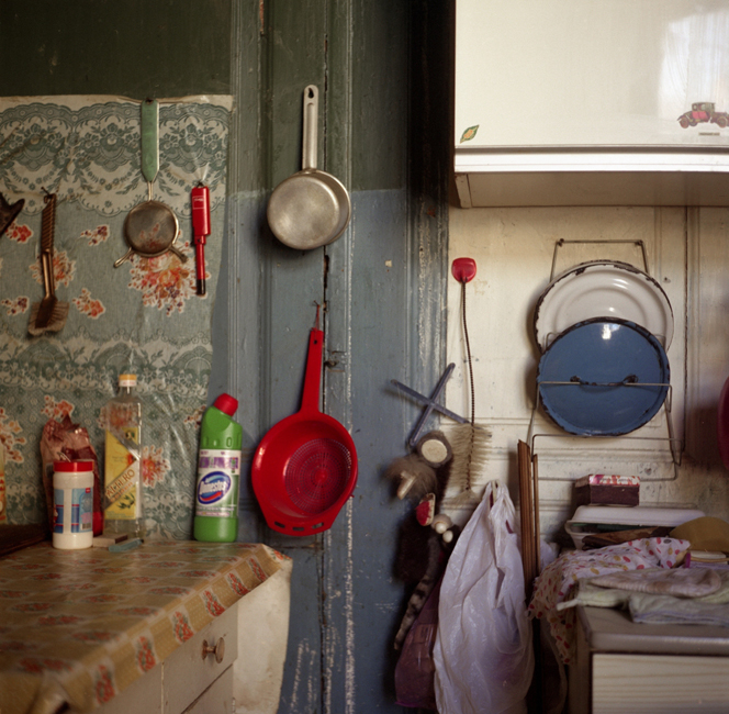 The interior of a kitchen in a communal apartment. Every family usually has a cooking table, a cupboard, etc., of their own. Kitchens corridors, toilets, and bathrooms in communal housing are referred to as 'public use space' and are not always well maintained.