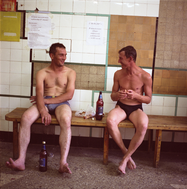 Men relaxing after having a bath in a public bath. There is still no hot water in many communal apartments, so people have to go to public baths to wash.