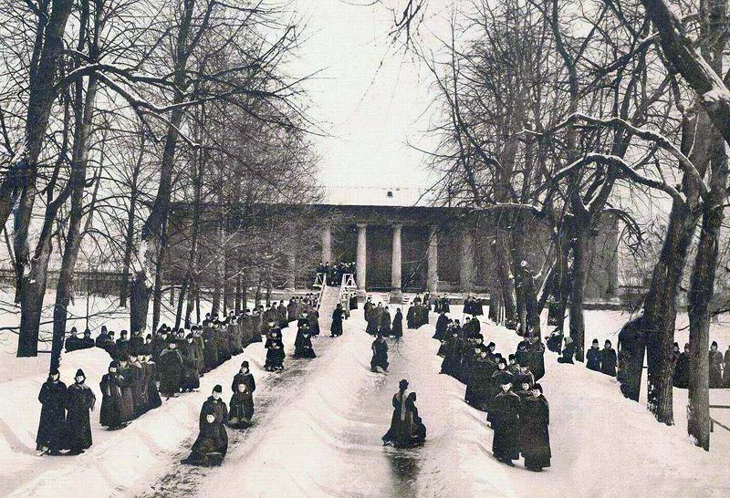 Changes were introduced to the students' lives in 1859, when the prominent pedagogue Konstantin Dmitrievich Ushinsky was appointed the institute's inspector. He made changes to the school's curriculum and, most importantly, instituted vacation since raising young girls apart from their families negatively affected their lives later on down the road. // Sledding from a hill