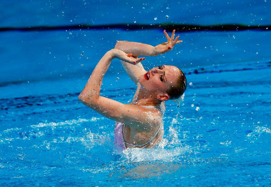 Die Synchronschwimmerin Swetlana Romaschina ist seit 2005 Mitglied der Nationalmannschaft Russlands. Seitdem wurde sie dreimal Olympiasiegerin, fünfzehnmal Weltmeisterin und siebenmal Europameisterin. Auf dem Foto: ihr Auftritt im Solo-Programm 2013.