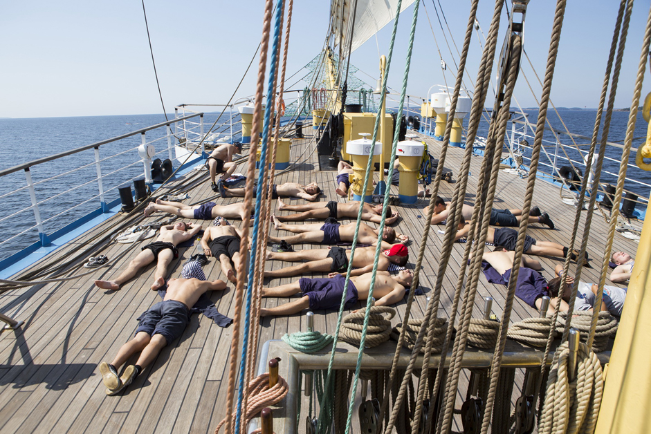 After all hands on deck, the best way to relax is snoozing in the sunshine. Whereas the stern of the vessel belongs to the ship's officers, the bow is fully at the disposal of the cadets.