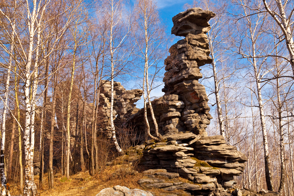 The Seven Brothers in the Chelyabinsk region's Ural Mountains is a group of steep cliffs that are tall for a steppe zone. These rock figures are the source of many legends among locals. The cliffs are 30-35 meters high. The gigantic rocks are formed of gray tiny crystal formations, most likely diabase or dolerite.