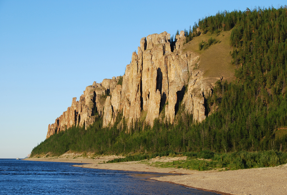 "The Lena Pillars in Yakutia on the Sinyaya River. The rocky shores that make up the ""Pillars"" stretch here for dozens of kilometers. They reach 100 meters in height and create unbelievable views. The Pillars were formed out of limestone that was created approximately 550 million years ago. The pillars themselves are younger; they're ""only"" about 400 thousand years old."