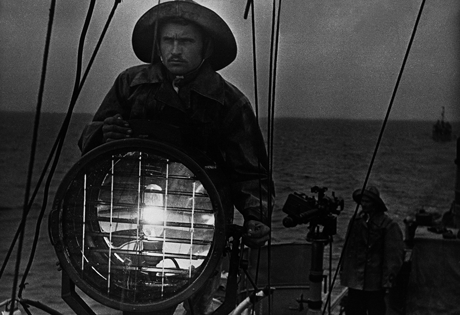 From 1937 to 1938, he presented his photographs at the First All-Union Photo Art Exhibition, including the outstanding image 'Kiev Train Station', and received a Grade I Diploma. // Signal. Fishermen keeping watch. Caspian Sea. 1936