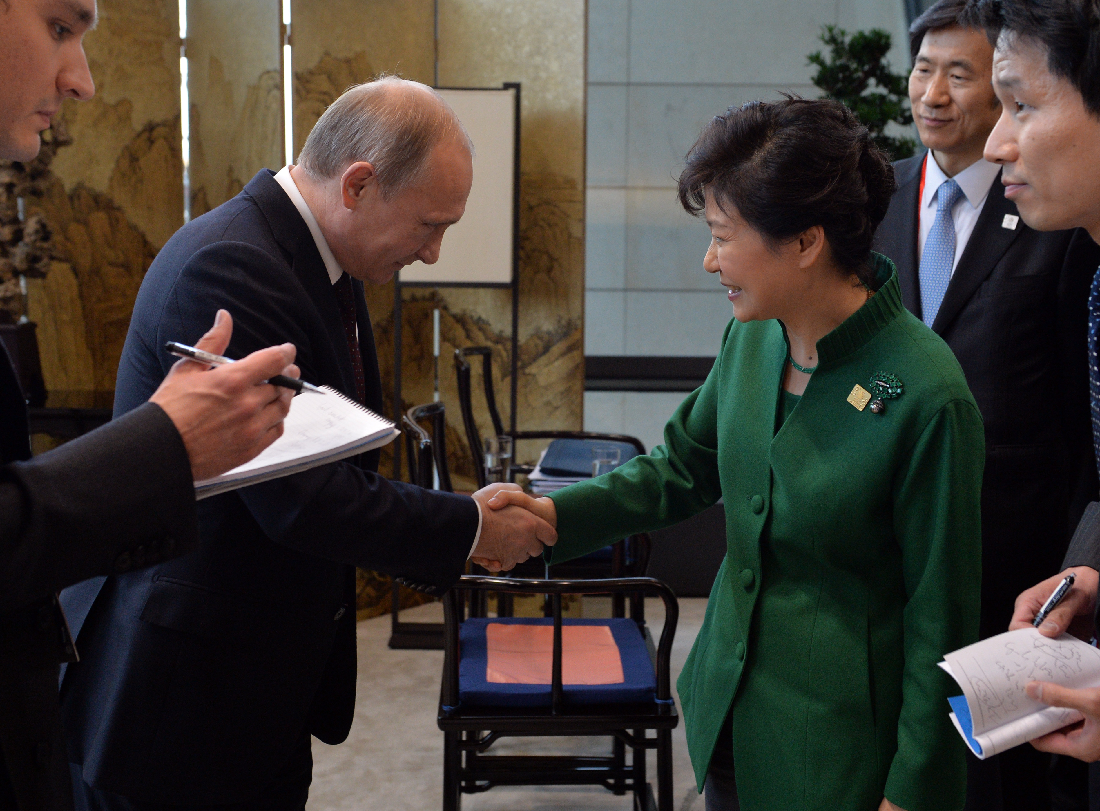 November 2014. Putin exchanges an official handshake with South Korean President Park Geun-hye at the APEC Summit. No shawls were involved.