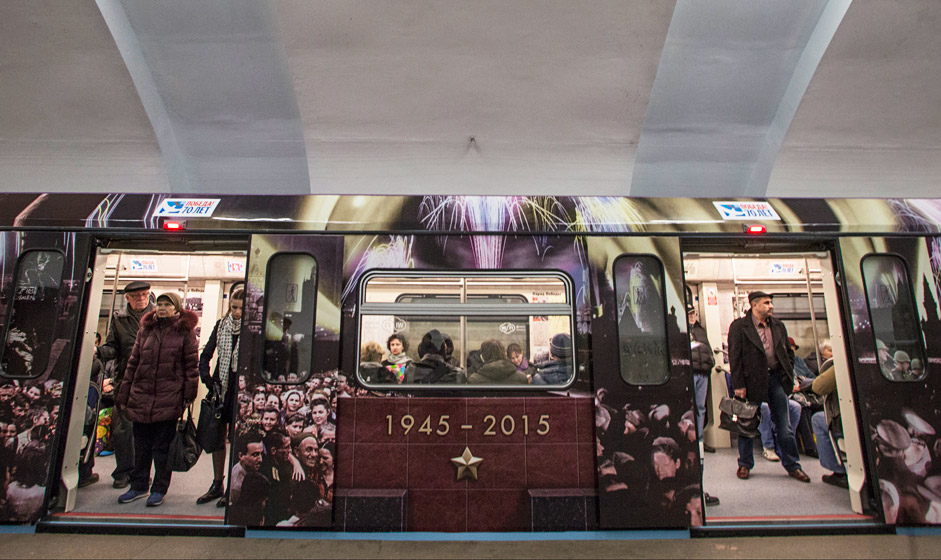 Passengers ride aboard a subway train decorated with World War II era posters during its first trip in Moscow, April 22, 2015. Russia will celebrate the Victory in WWII on May 9, 2015.