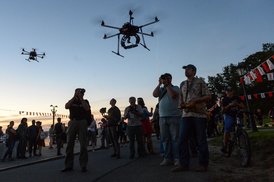 Parade participants and local residents attend a workshop on drone photography during the Uglich Photo Parade festival