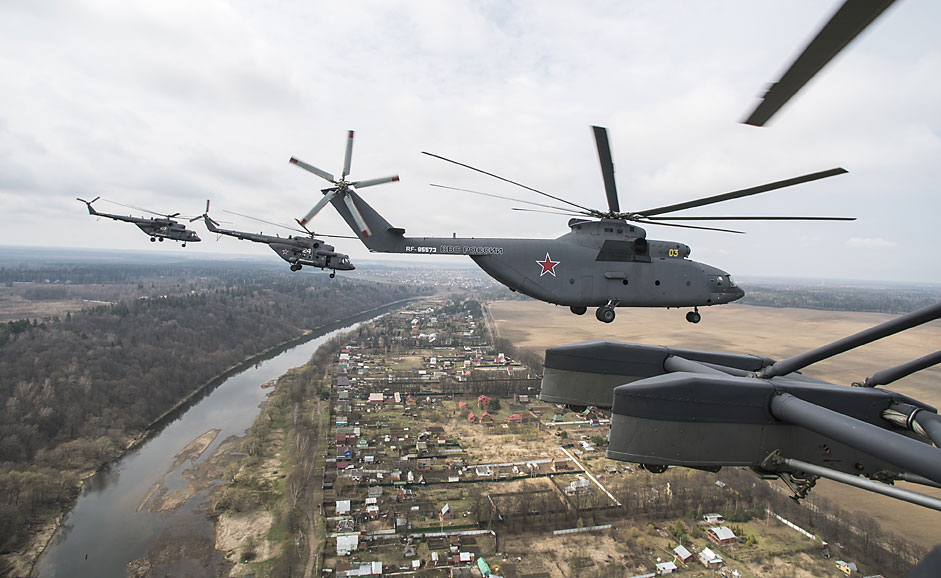 Mil Mi-26 and Mi-8 helicopters fly over the Moscow Region during a dress rehearsal of the May 9 Victory Day military parade.