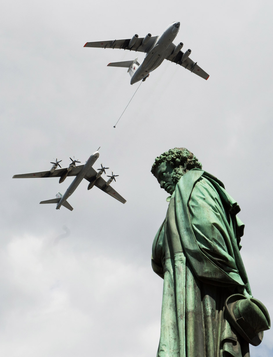 Ilyushin Il 78 and Tupolev Tu 95 planes fly over a statue of Russian poet Alexander Pushkin in Moscow during a rehearsal of the May 9 Victory Day military parade.
