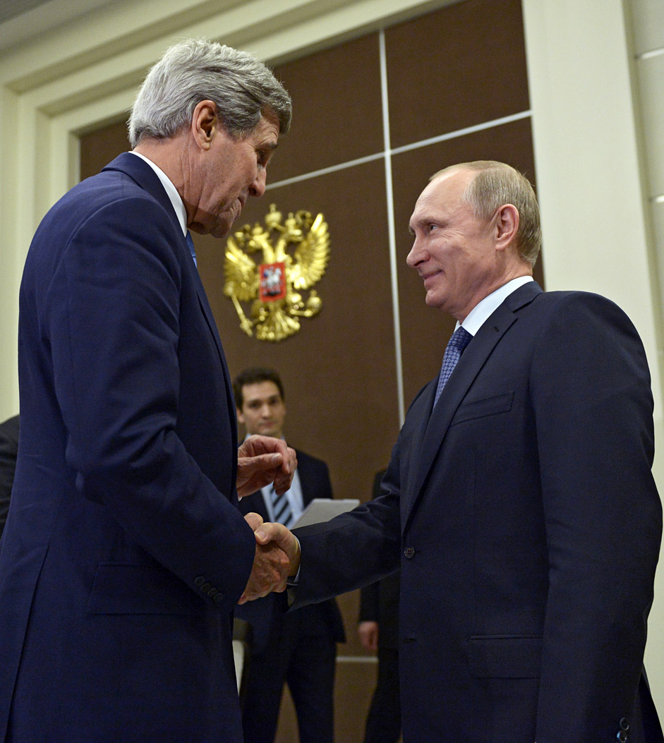 U.S. Secretary of State John Kerry is welcomed by Russian President Vladimir Putin at the presidential residence of Bocharov Ruchei in Sochi, on May 12
